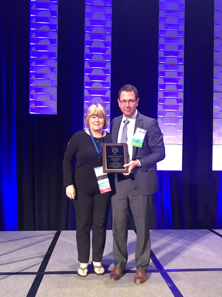 SGNA Appreciation Award: Presented to Theresa Klein by Dr. Michael Wallace